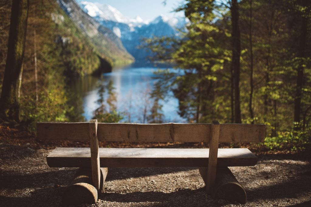 park bench view of mountains