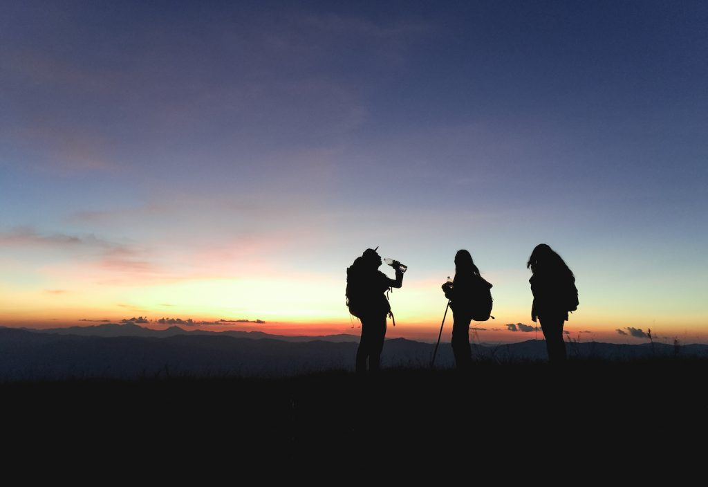 purpose, vision, mission with three hikers at sunset