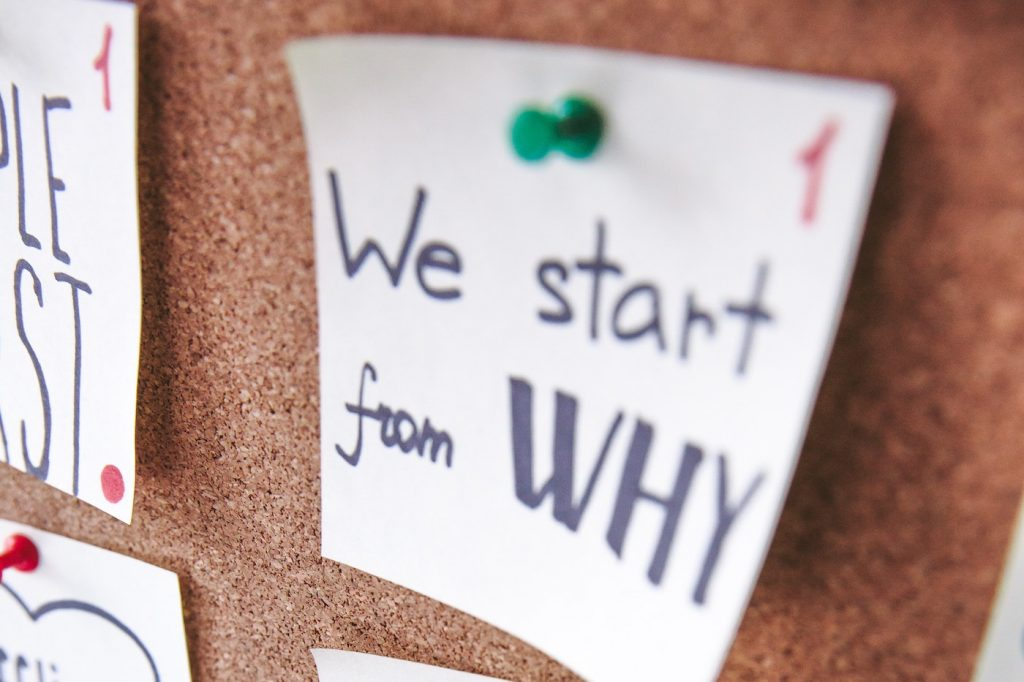 White post-it note that says We Start With Why